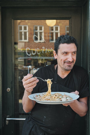 One BIG HAPPY FAMILY - The first thing you need to know about Ca´ Cucina is that we are one big happy family, working together to cook and serve you some of the most delicious Italian food you have ever tasted.When you meet the owner, Diego, you will know why. He knows the name of almost everyone who regularly visits Ca´ and almost everyone who is passing by outside.Trained in Italy and having worked in 2 continents, Diego has become a master in Italian home cooking and is very happy to share his passion for food with his guests.