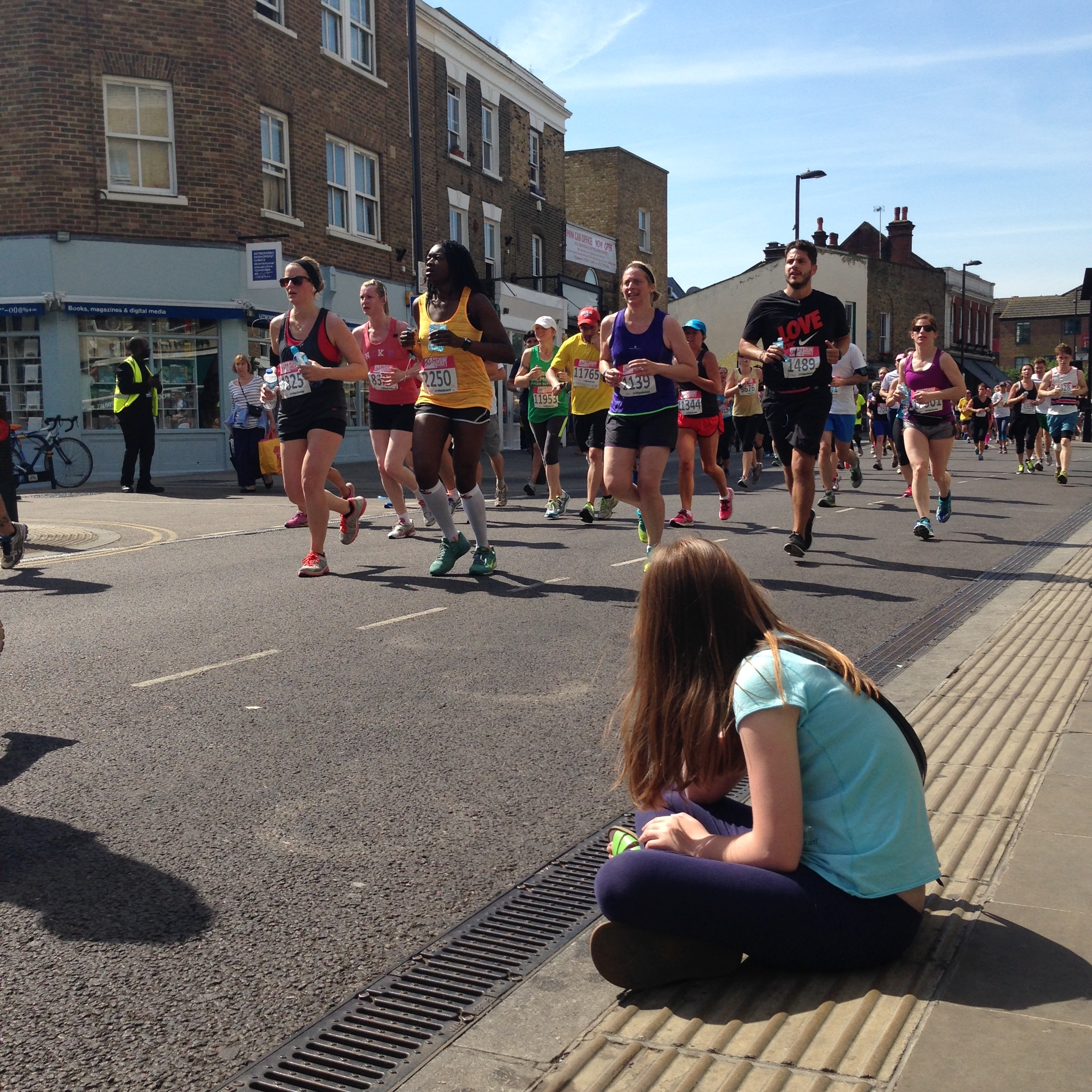 Runners on Broadway Market in the Hackney Half marathon, which returns in May.