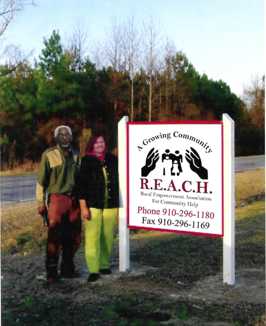 REACH founders Devon Hall and Dothula Baron-Hall   The Rural Empowerment Association for Community Help (REACH), a 501(c)(3) nonprofit organization, was founded in 2002 by Duplin County residents Devon Hall and Dothula Baron-Hall in the aftermath of Hurricane Floyd to provide services to empower low-income families and people of color. The organization has also sought to address potential health effects of living close to industrial agricultural facilities, problems stemming from mental and emotional oppression, economic inadequacies, employment and education needs, lack of single family housing, racial and cultural imbalances, and limited youth programs and services.