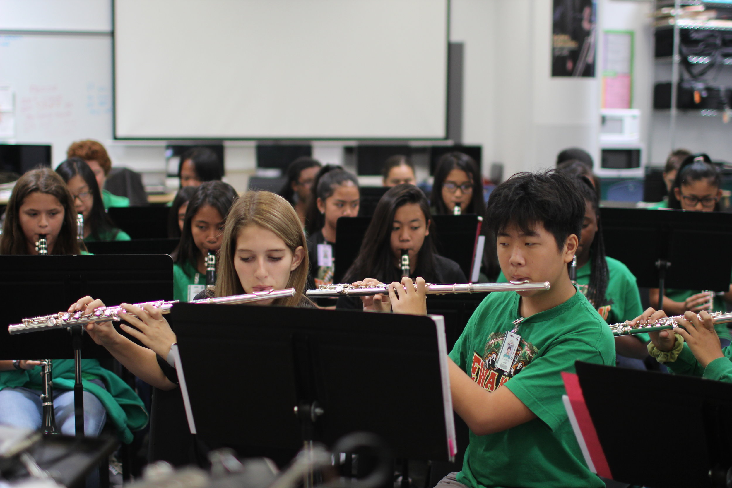 Ewa Makai students in band class playing instruments.