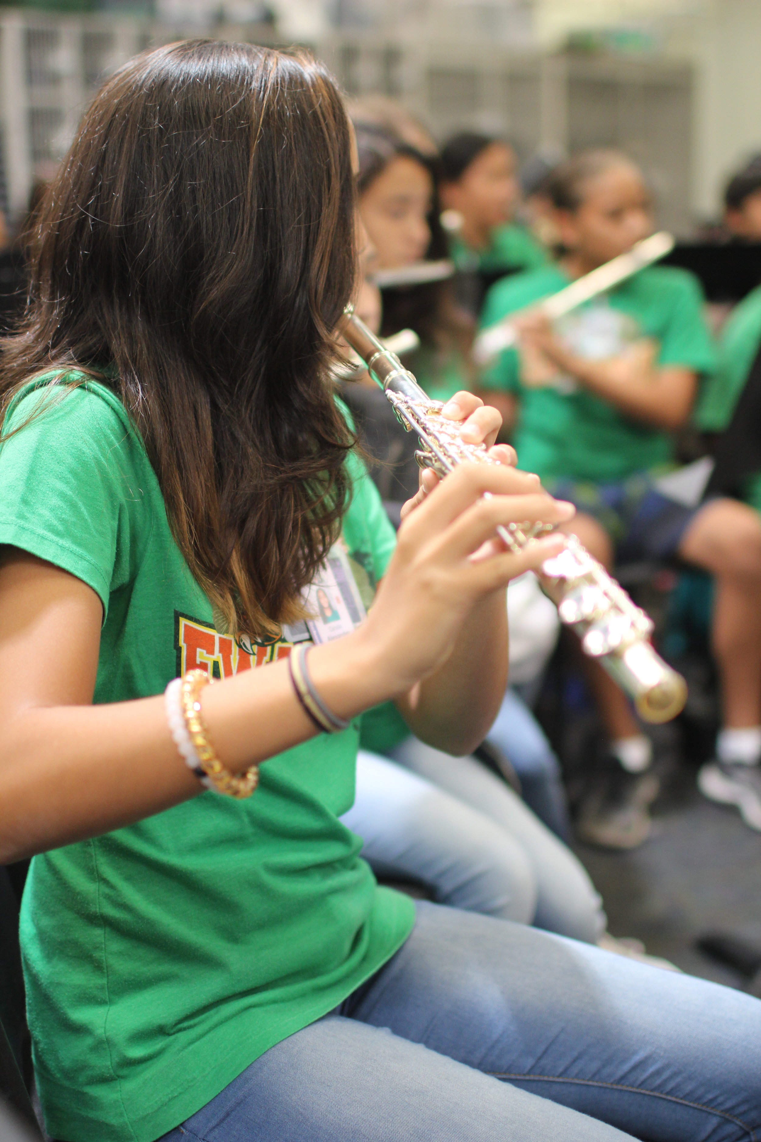 Ewa Makai student in band class playing a flute.