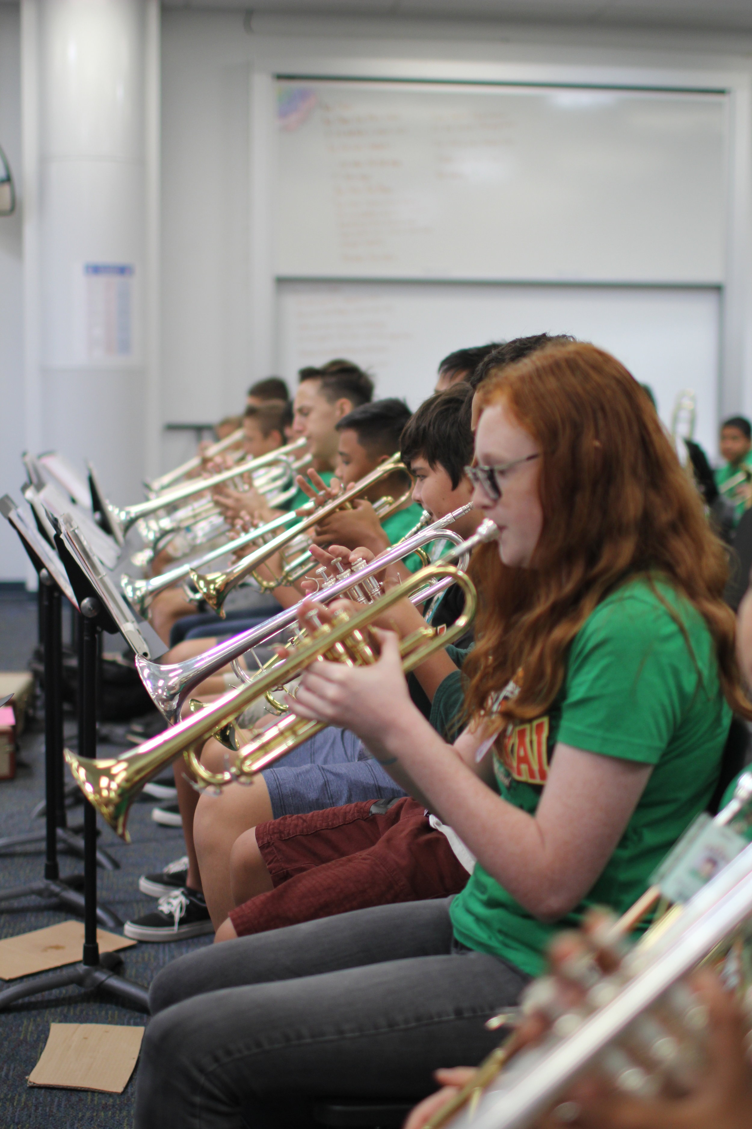 Ewa Makai students in band class playing trumpets.