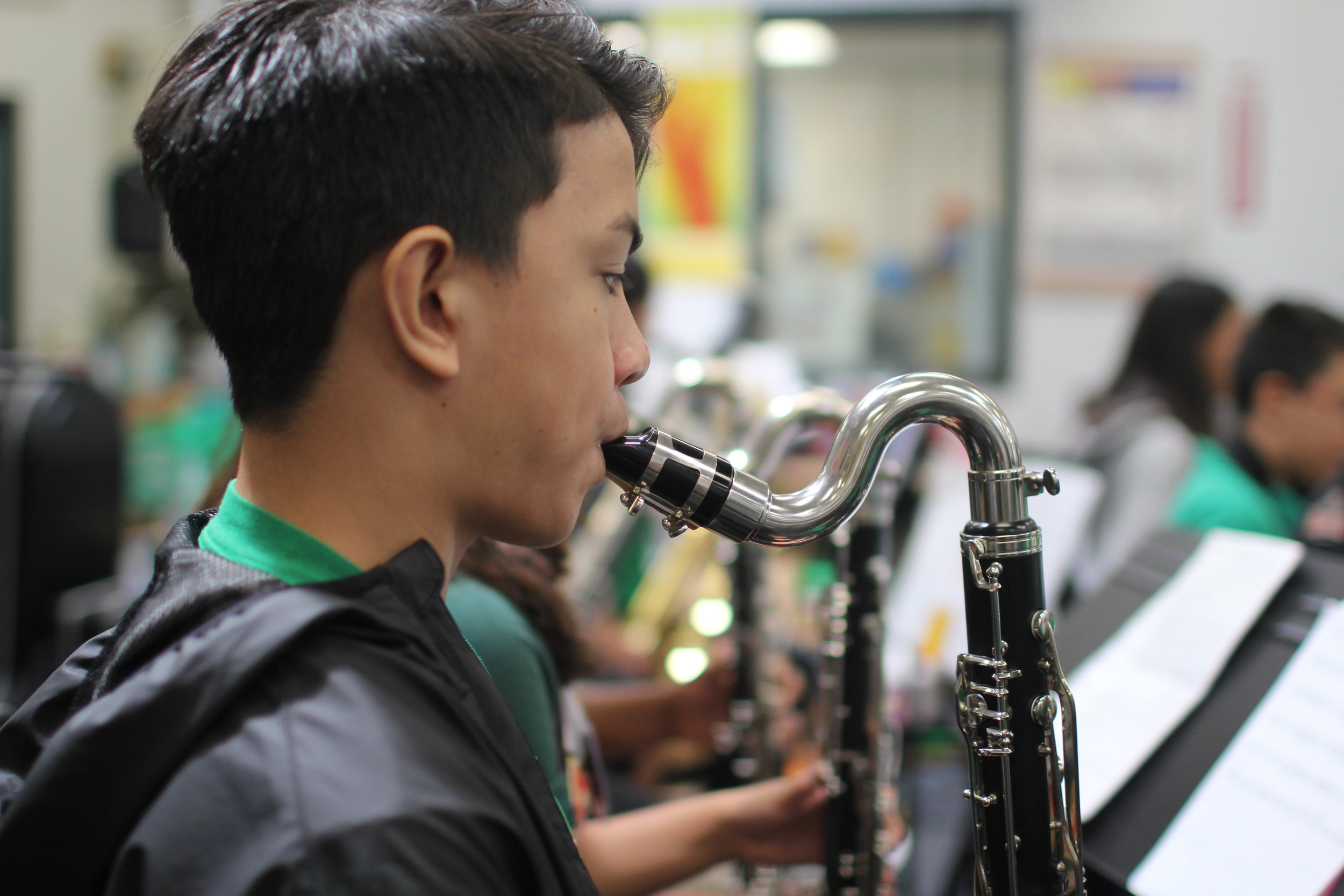 Ewa Makai student in band class playing a saxophone.