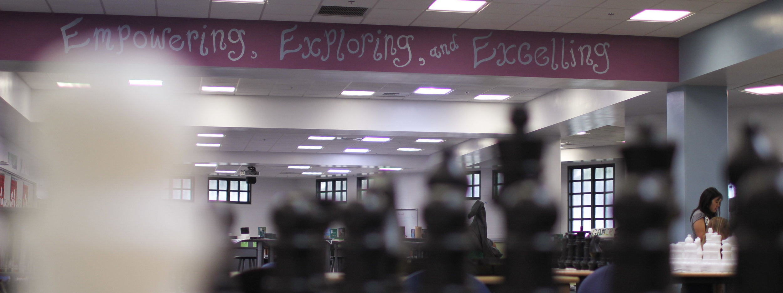 """""""Empowering, Exploring, and Excelling"""" painted in Ewa Makai Middle School's library."""