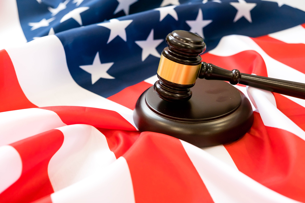 US flag with judges gavel and hammer