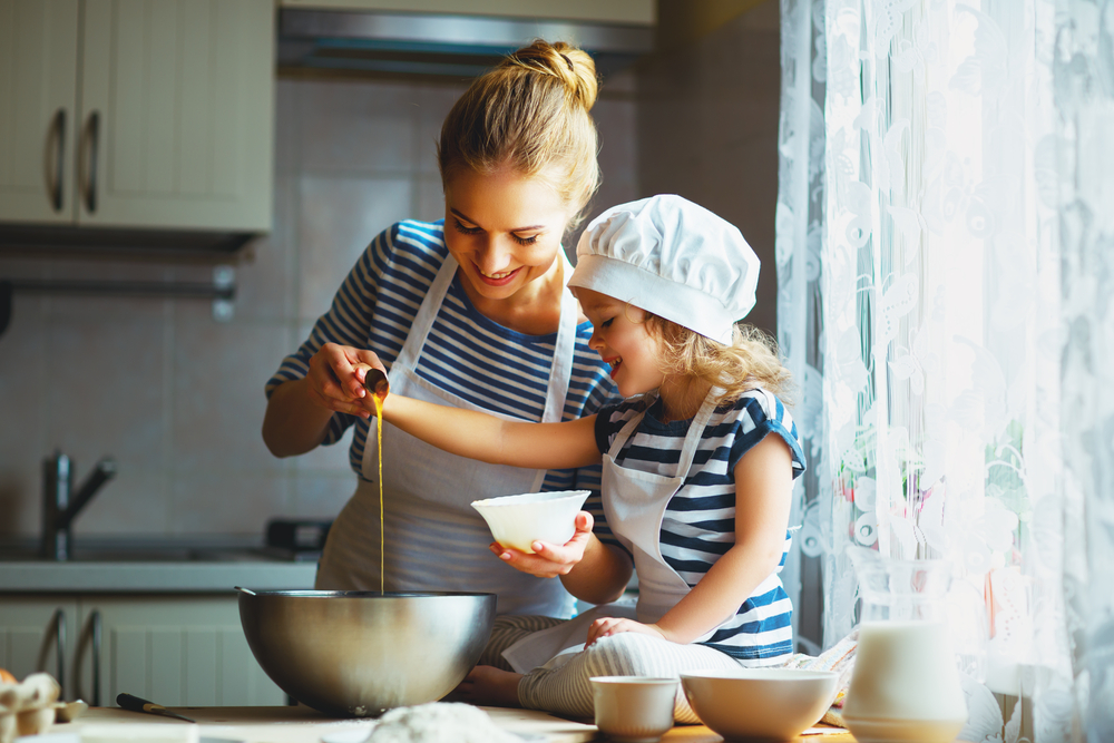 Mother with child at kitchen