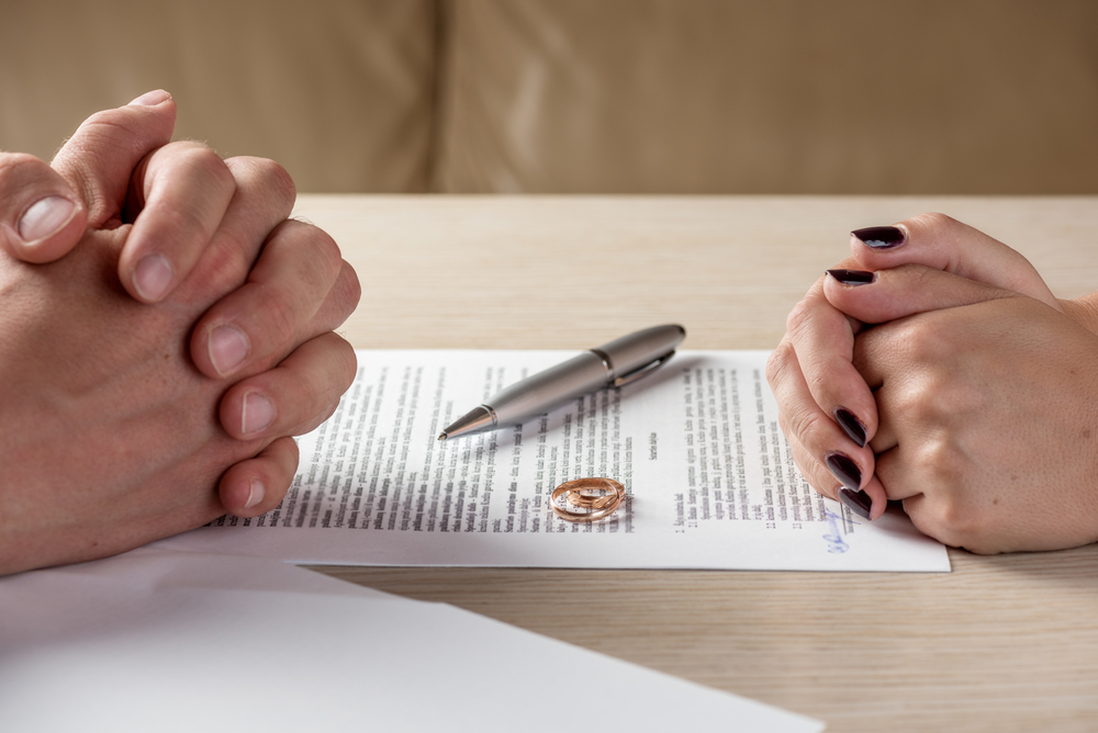 Divorce paper and A pen On Table