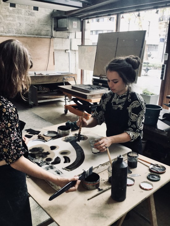 Mathilde (right) working away in her atelier.