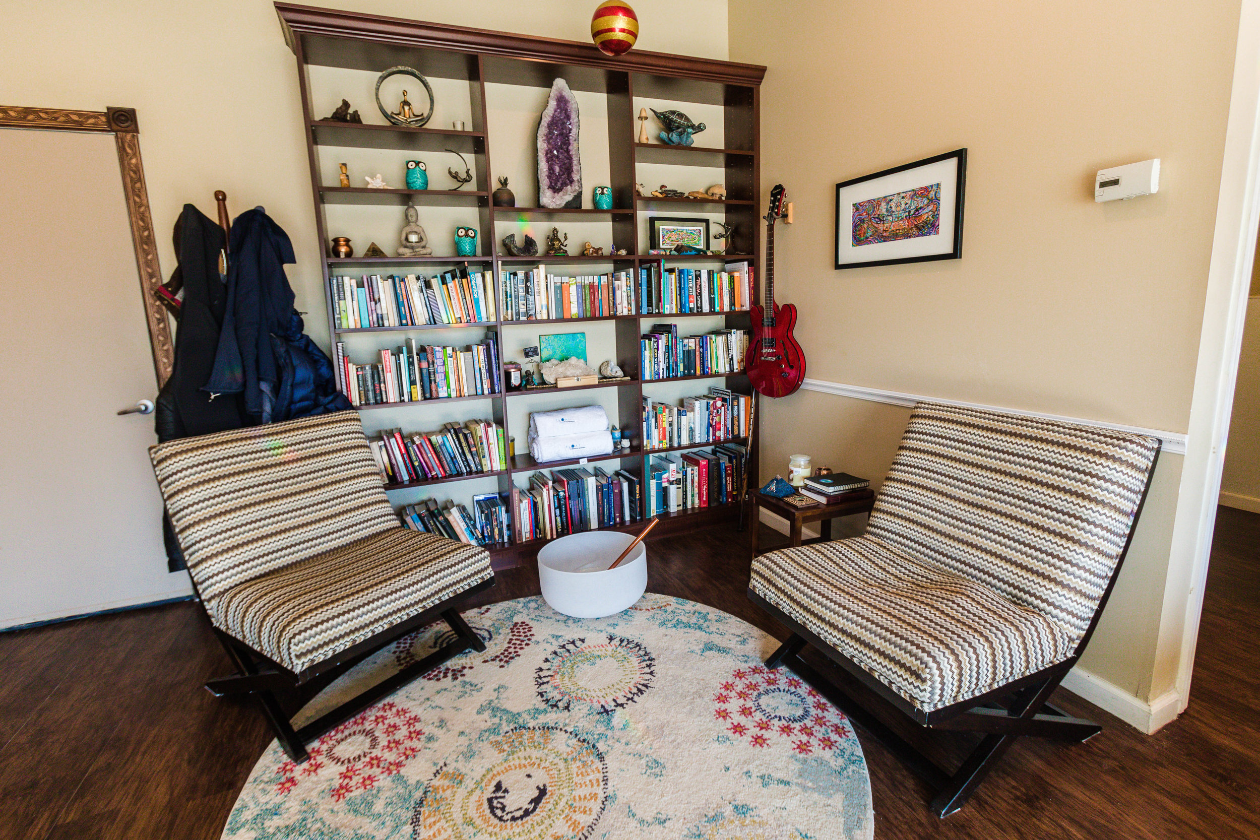 Full Bookshelves and Seating In Our Lobby
