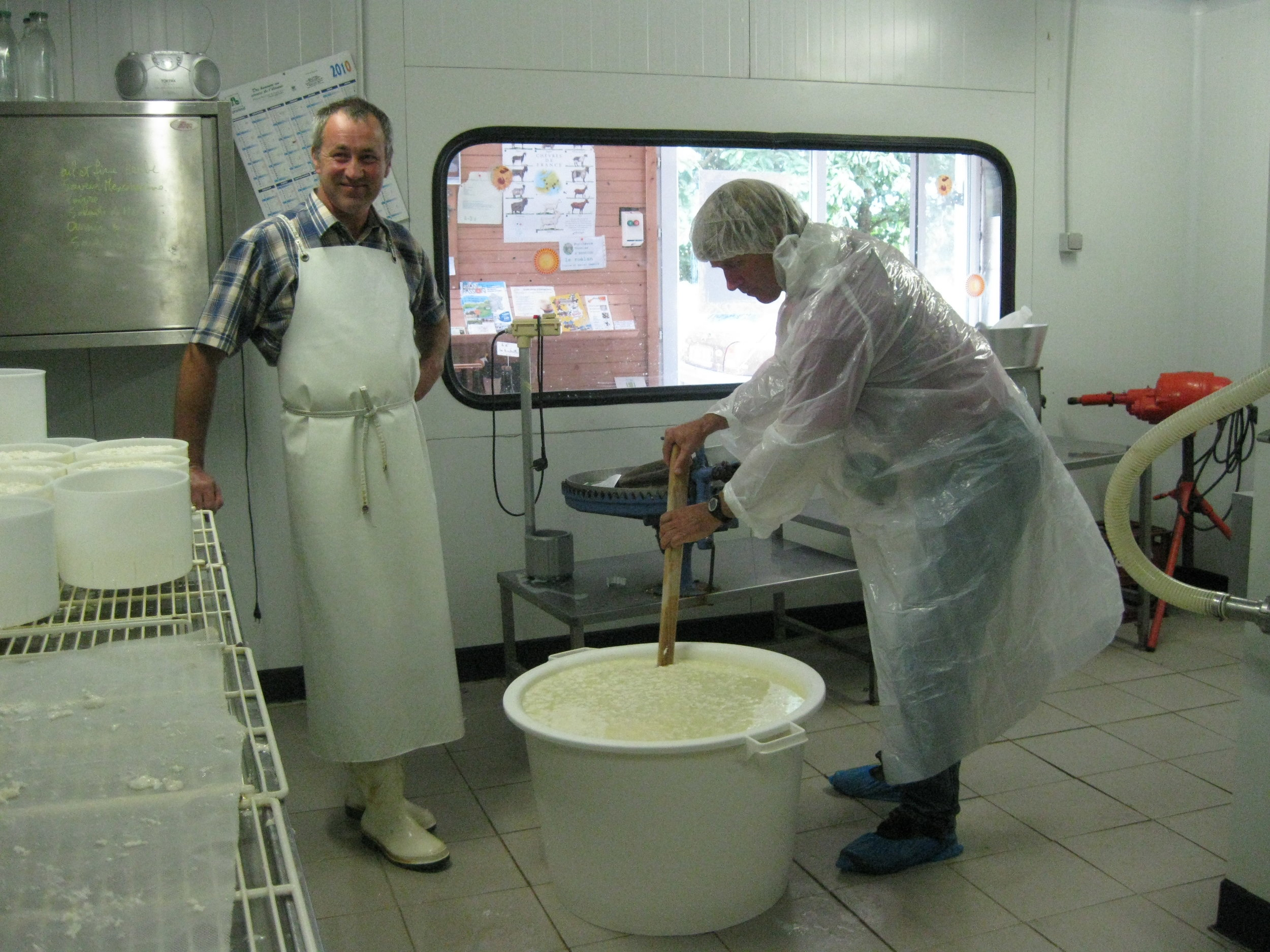 Geoff learning the art of mixing curds with French Cheesemaker, Alain, 2010.