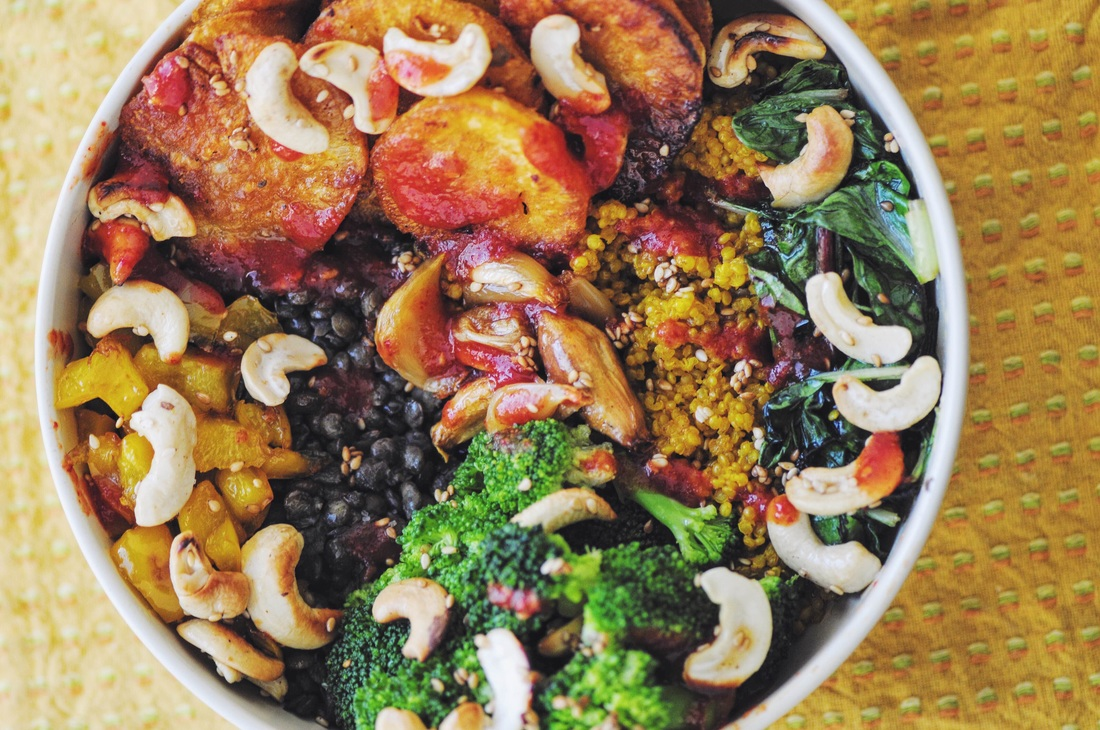 Hearty, healthy, comforting, and delicious Warming Winter Buddha Bowl filled with turmeric sprouted quinoa, french green lentils, paprika & garlic roasted sweet potatoes, broccoli, bell peppers, wilted greens, cashews, sesame seeds, and a generous drizzle of sriracha! Gluten-free and vegan. #buddhabowl #rainbowbowl #vegan #glutenfree #quinoa #lentils #sweetpotatoes #broccoli #cashews #healthy #lunch #dinner