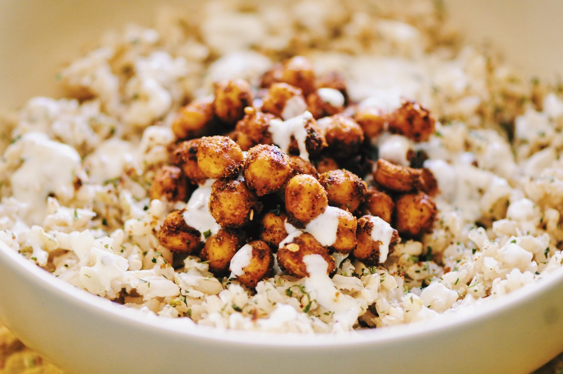 This Coconut Ginger Rice Bowl with Spicy Turkish Roasted Chickpeas and a drizzle of Garlic Yogurt sauce makes for one super delicious, healthy, and filling gluten-free vegan lunch or dinner! #rice #lunch #dinner #healthy #coconut #ginger #spicy #turkish #chickpeas #garlic #yogurt #sauce #roasted #glutenfree #vegan #meal