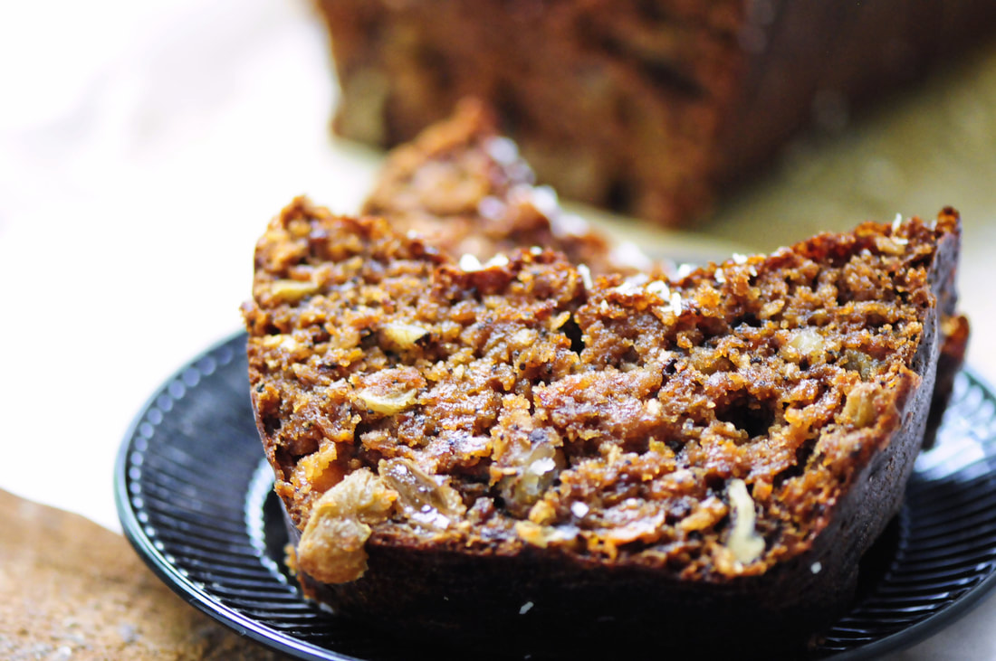 An absolutely scrumptious gluten-free morning glory bread packed with apples, carrots, raisins, walnuts, coconut, greek yogurt, and poppy seeds! Big on flavor, filling, and makes an excellent breakfast or afternoon treat with tea. #morningglory #morningglorybread #glutenfree #glutenfreebreakfast #applebread #carrotbread #raisinbread #healthybread #sweetloaf