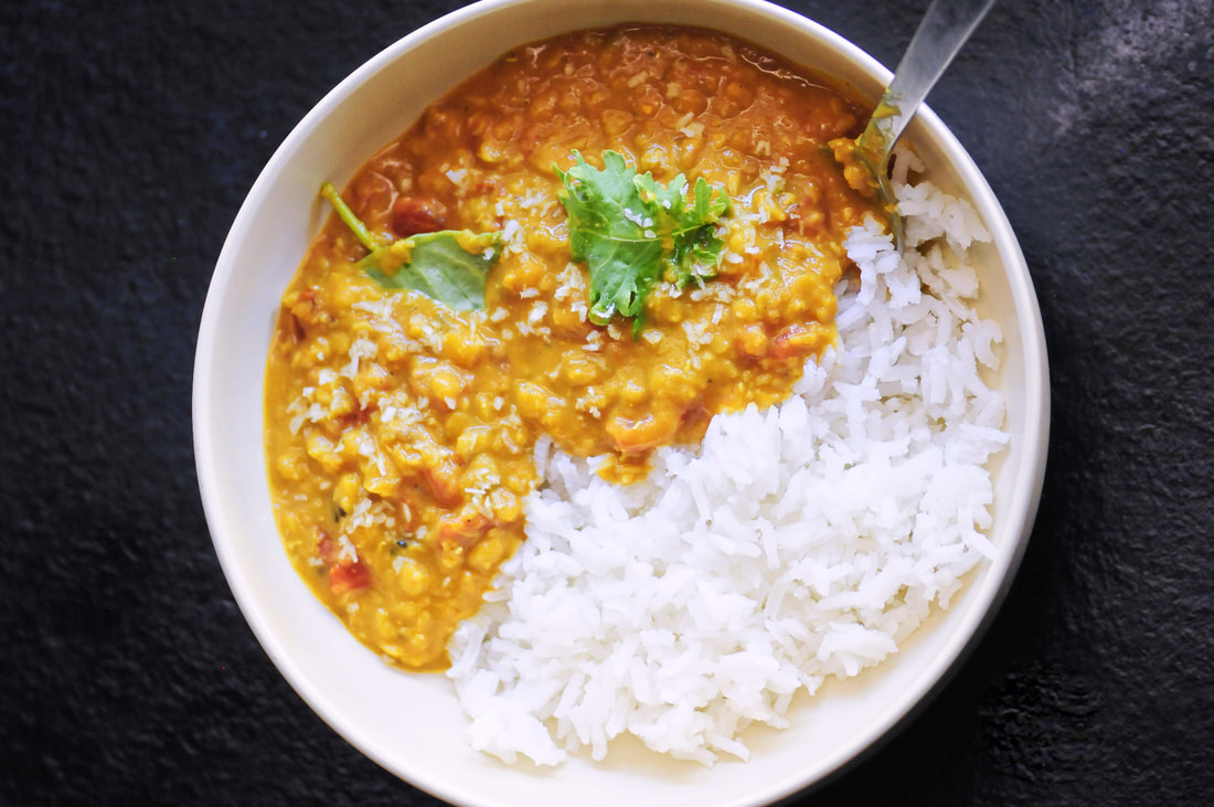 Cozy up with this quick, easy, & tasty one pot spicy coconut dal made with red lentils, coconut milk, tomatoes, garlic, onion and the perfect blend of Indian spices. It makes a most delicious gluten-free, vegan dish served alongside some basmati rice or naan bread! #dal #dhal #daal #indianfood #curry #vegancurry #glutenfree #spicyfood #coconutcurry #redlentils