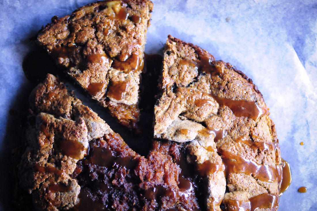 An intoxicatingly spiced apple and butternut squash filling enveloped in a gluten-free chai tea infused buckwheat crust drizzled with a delectable coconut caramel drizzle. This rustic pie makes for the perfect autumn dessert! #glutenfreegalette #applegalette #butternutsquashgalette #chaipie #buckwheatpiecrust #coconutcaramel #glutenfreepie #dessert #autumn