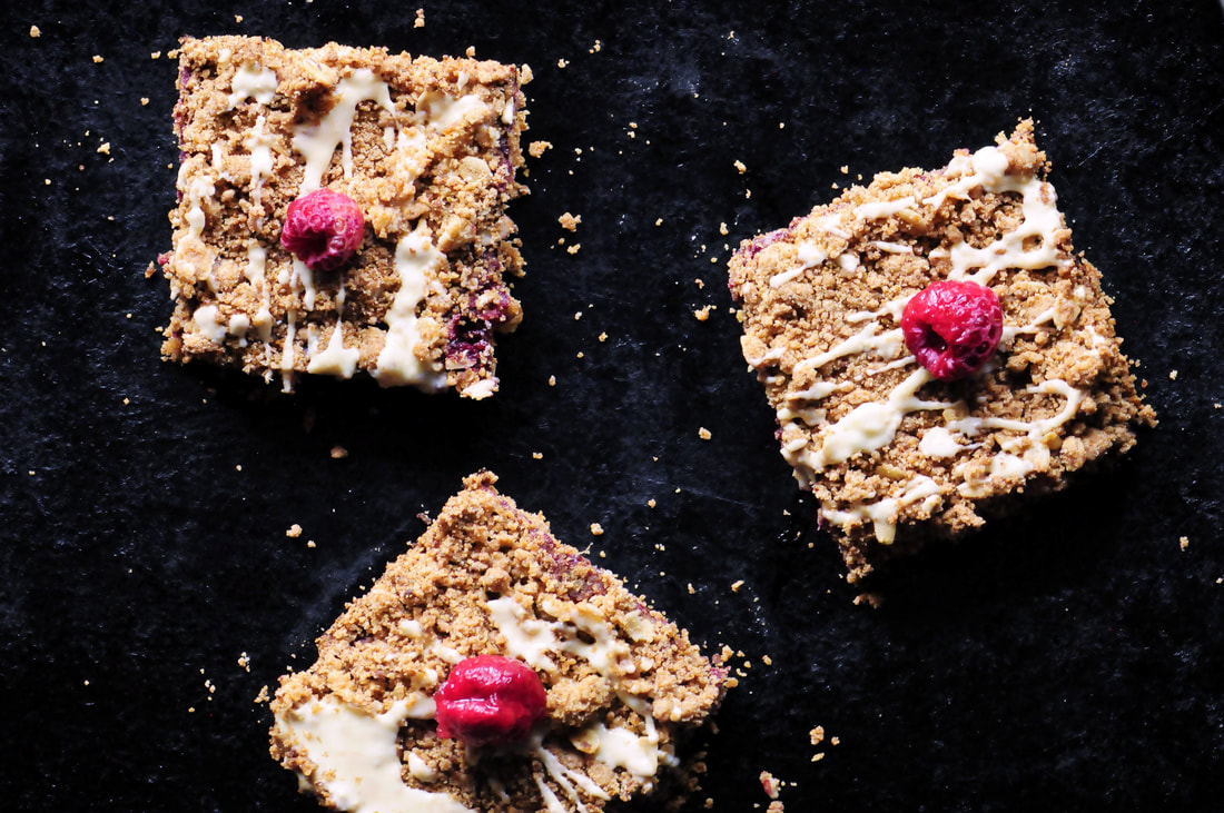 These Raspberry Gingerbread Crumble Bars are made with a delectably spiced buttery oat crust filled with a luscious raspberry chia seed jam and then drizzled with white chocolate! They make for one beautiful, easy, delicious and festive gluten-free treat! #raspberrybars #gingerbreadbars #glutenfreebars #gingerbread #chiaseedbars #whitechocolate