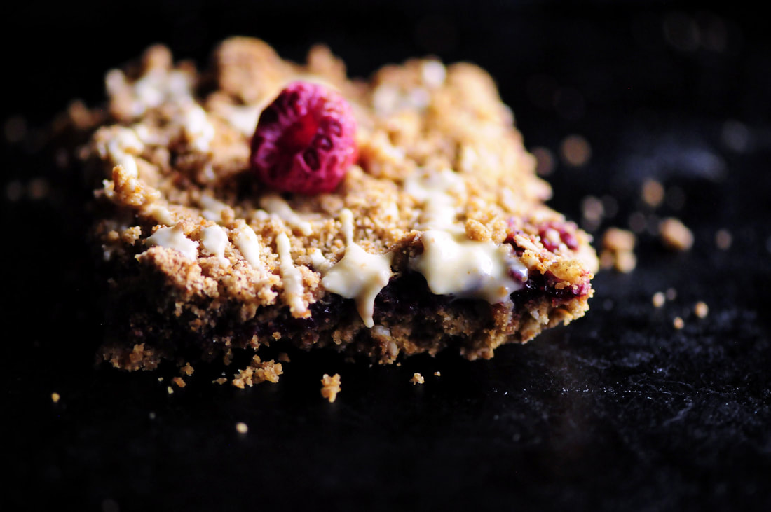 These Raspberry Gingerbread Crumble Bars are made with a delectably spiced buttery oat crust filled with a luscious raspberry chia seed jam and then drizzled with white chocolate! They make for one beautiful, easy, delicious and festive gluten-free treat! #raspberrybars #gingerbreadbars #glutenfreebars #gingerbread #chiaseedbars #whitechocolate #chiajam