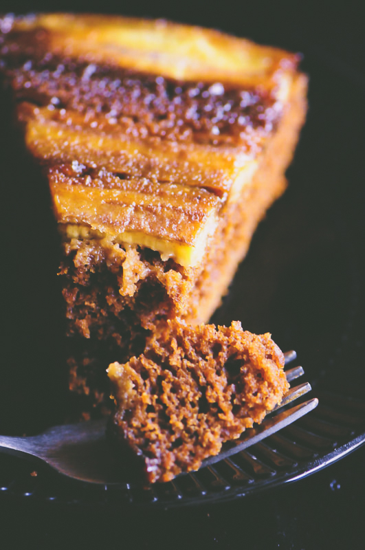 This Upside Down Caramelized Gingerbread Banana Cake is gluten-free, super quick and easy to make, and is incredibly delicious with its perfectly spiced gingerbread base topped with sticky caramelized bananas. It makes for one perfect holiday dessert certain to impress the pickiest of guests! #upsidedownbananacake #upsidedowncake #gingerbreadcake #glutenfreecake #caramelizedcake