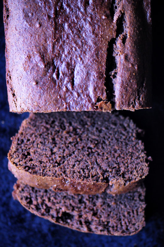 A rich, moist, decadent gluten-free banana bread made with buckwheat flour, almond flour and raw cacao powder. This beautiful loaf is created with wholesome ingredients, and sweetened by unrefined coconut sugar, making it a scrumptious treat that is deliciously healthy any time of the day! #chocolatebread #buckwheatbread #glutenfreebread #bananabread #cacao