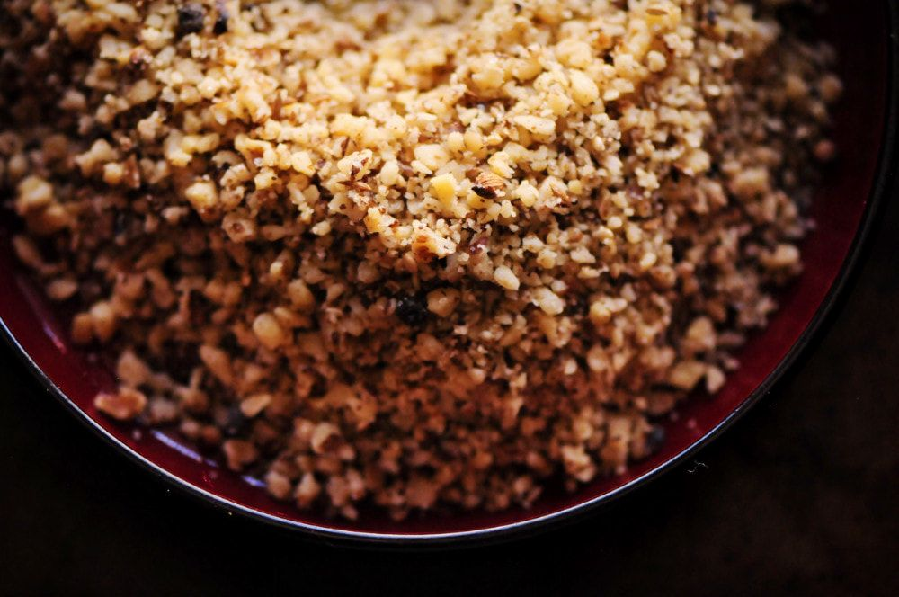 This easy, beautiful and delicious Roasted Walnut Dukkah is made with a blend of walnuts, sesame seeds, cumin seeds, coriander, black peppercorns, and sea salt. You'll find yourself putting this Egyptian condiment on anything and everything as you fall in love with its complex flavors and pleasing textures! #dukkah #duqqa #egyptian #condiment #walnutdukkah #spiceblend