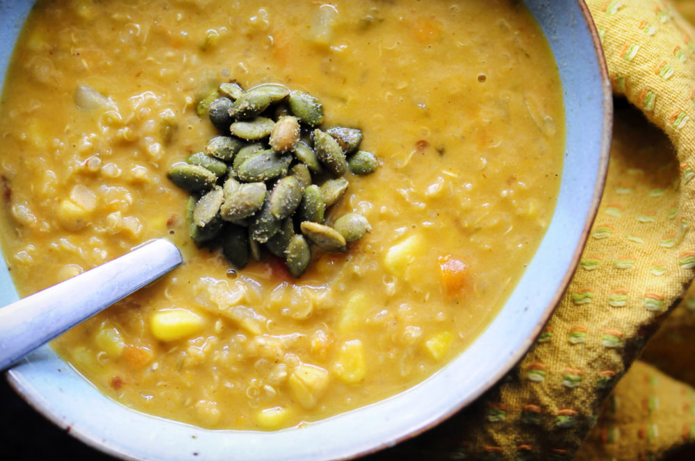 An easy, healthy, and delicious protein-packed gluten-free vegan Southwestern Chowder chock-full of corn, potatoes, quinoa, red lentils, green chiles, chipotle peppers, veggies and an amazing blend of spices. This amazingly delicious vegetarian chowder is incredibly filling, comforting, and flavorful and makes a great lunch or dinner! #vegancornchowder #quinoasoup #spicychowder #southwesterncuisine #potatochowder #lentilchowder #glutenfreechowder