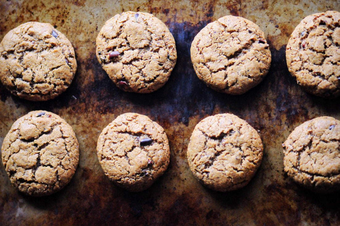 Easy, healthy, and delicious One Bowl Peanut Butter Cacao Nib Coconut Flour Cookies. Gluten-free, Dairy-free, Refined Sugar-free cookies that are perfectly chewy and oh so TASTY! #glutenfreepeanutbuttercookies #cacaonibcookies #coconutflourcookies #glutenfreecookies