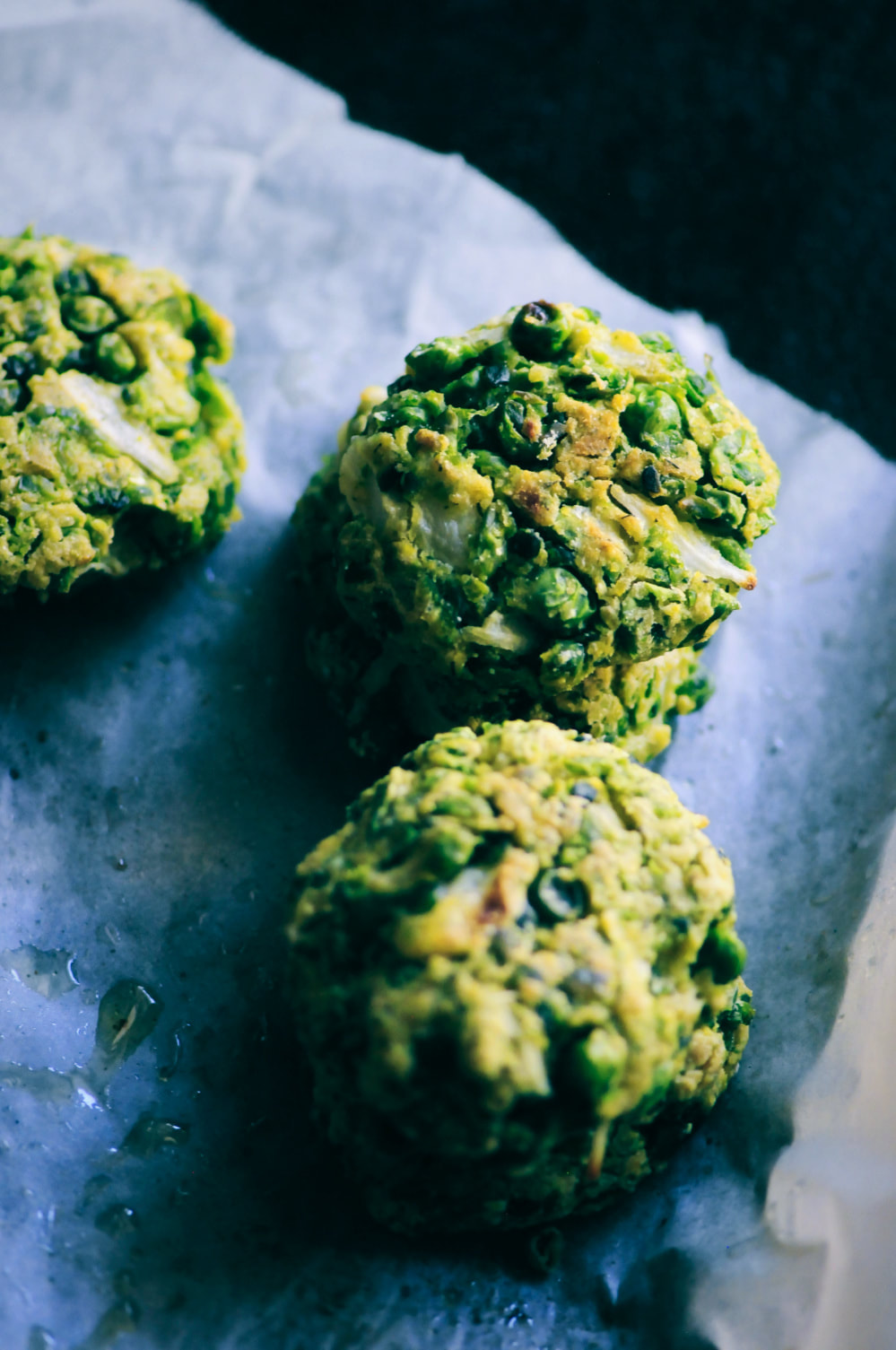 These easy, healthy, and delicious Baked Spring Pea and Dill Fritters with Lemon Tahini Sauce make a great gluten-free & vegan appetizer, snack, or meal! #peafritters #glutenfreefritters #veganfritters #greenfritters #dillfritters #lemontahinisauce