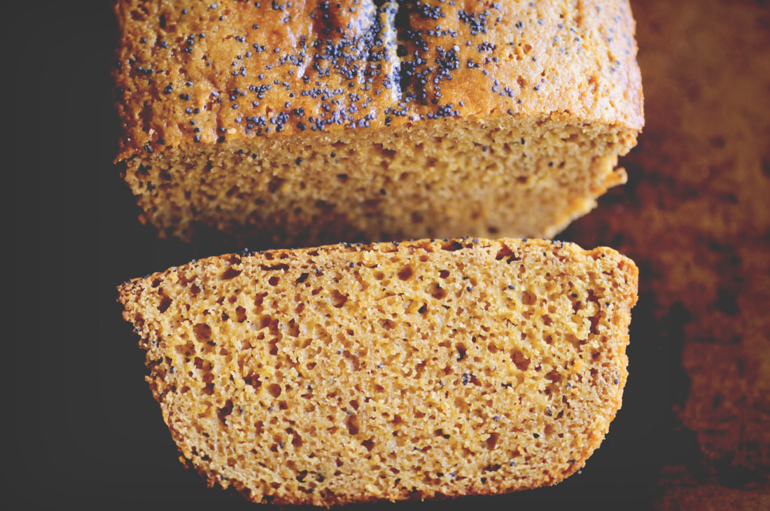 A perfectly moist, subtly sweet, lemon poppy seed loaf made with chickpea (garbanzo bean) flour! This gluten-free bread makes a great healthy breakfast, snack or dessert! #chickpeaflourbread #glutenfreelemonpoppyseedbread #lemonpoppyseed #garbanzobeanflour #glutenfreebread