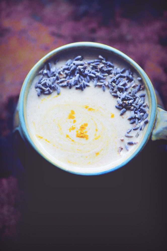 This Cherry Lavender Moon Milk makes for one creamy, delicious, calming and beautiful sleepy-time beverage for those evenings when you could use a little extra support. With a healthy blend of oats, walnuts, spices, sweet cherries, and plant-based milk, this warm and cozy drink makes for one comforting vegan gluten-free remedy with its roots in Ayurveda. #moonmilk #cherrymoonmilk #lavendermoonmilk #sleepdrink #elixir #ayurvedicdrink #veganmilk