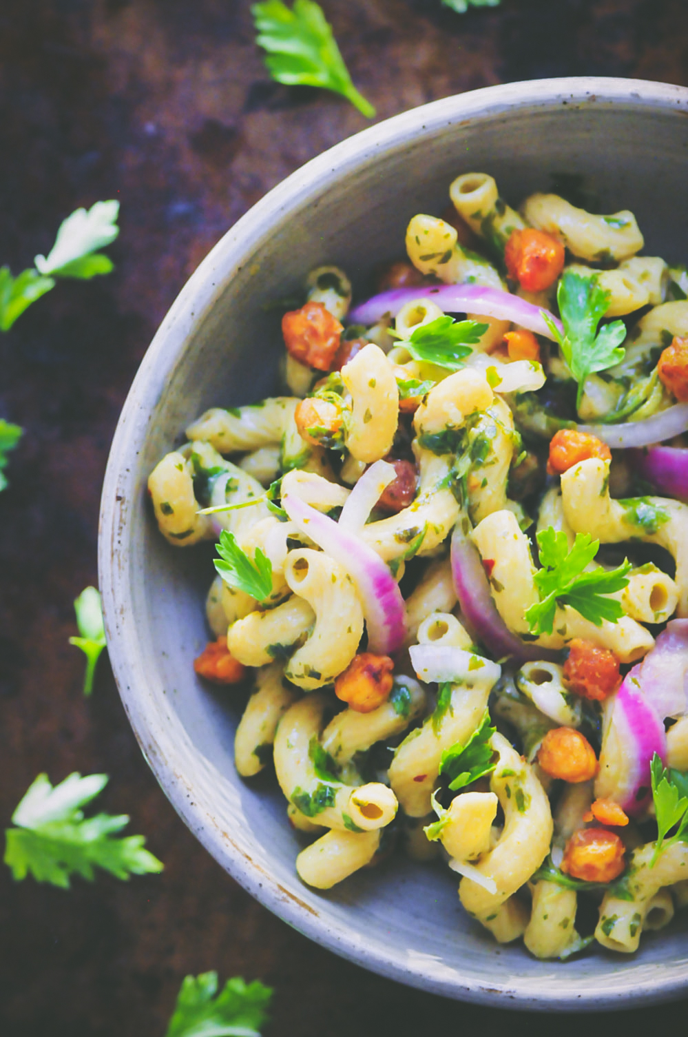 This Spicy Chimichurri Chickpea Pasta Bowl is super flavorful, healthy, easy to make, gluten- free, vegan, and packed with protein and fiber! #chimichurripasta #spicypastasalad #glutenfreepasta #veganpastasalad #chickpeapasta