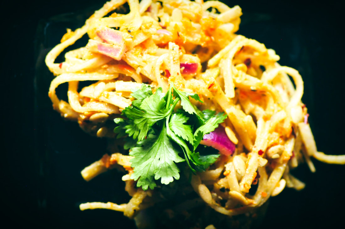 This Spicy Pumpkin Seed Butter Pad Thai makes for one flavorful and healthy vegan, gluten-free, soy-free, and nut-free lunch or dinner ready in only 20 minutes! #veganpadthai #nutfreepadthai #glutenfreepadthai #spicypadthai #pumpkinseedbutter