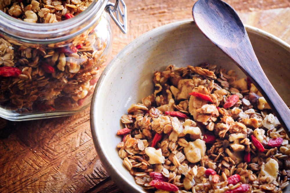 This easy, healthy and delicious Maple Walnut Goji Berry Granola makes for one satisfying gluten-free vegan breakfast, snack or refined sugar-free treat! #gojiberrygranola #trailmix #walnutgranola #maplegranola #vegangranola #glutenfreegranola #gojiberries