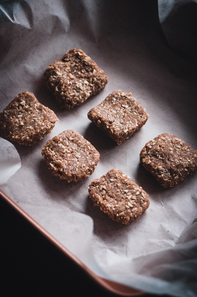 These gluten-free and vegan No Bake Super Seed Cinnamon Maca Energy Squares are filled with energy boosting and hormone balancing properties; as well as being high in protein, iron, calcium, B vitamins, selenium, folate, fiber, omega-3's and vitamin E. They make for one flavorful and nourishing healthy treat that is easy to make, too! #nobakebars #macabars #energybars #veganbars #seedbars #glutenfreebars #hormonebalancing