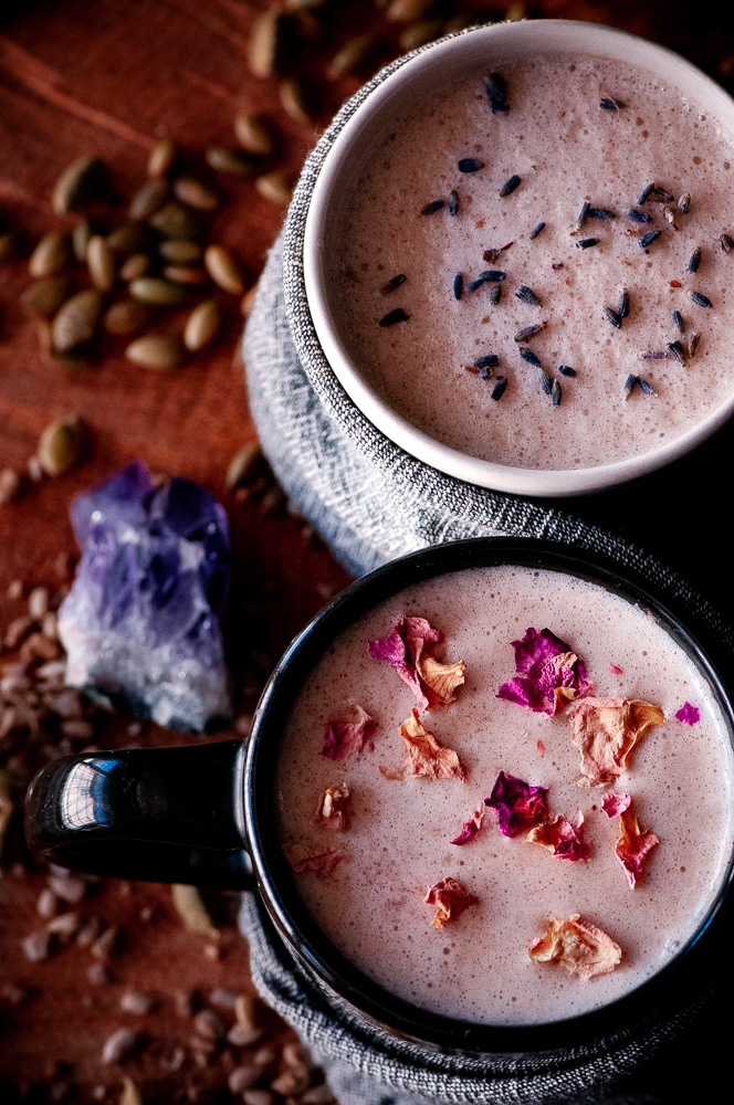 These vegan moon milk recipes make a healthy, easy & delicious way to balance your hormones with the use of seed cycling for hormone balance. These seed cycling moon milk recipes contain powerful nutrient-dense ingredients such as sunflower seeds, pumpkin seeds, rose petals, cardamom, cinnamon, coconut oil and lavender to complement your follicular & luteal reproductive phases to bring you more in sync with the moon & restore healthy menstrual cycles! #moonmilk #seedcycling