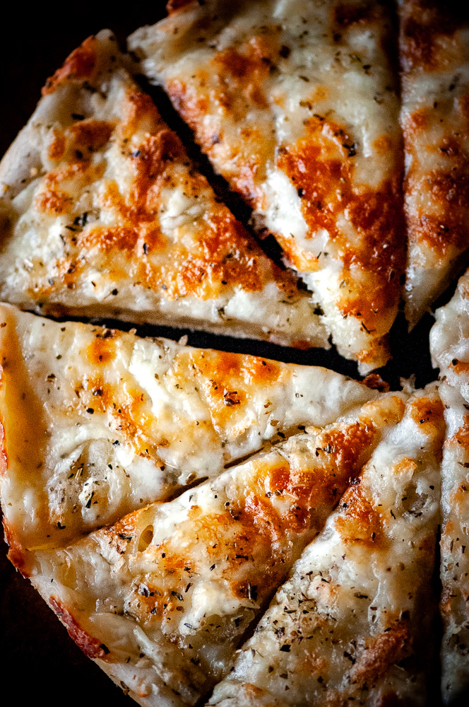 The absolute BEST EASY Gluten-Free Pizza Dough Recipe you will ever find! This Gluten-Free Pizza Crust is made with tapioca flour and is yeast free, gum free, and perfectly chewy (just like gluten containing crusts!). #glutenfreepizza #glutenfreepizzadough #glutenfreepizzaeasy #glutenfreepizzacrust #thebestglutenfreepizzacrust