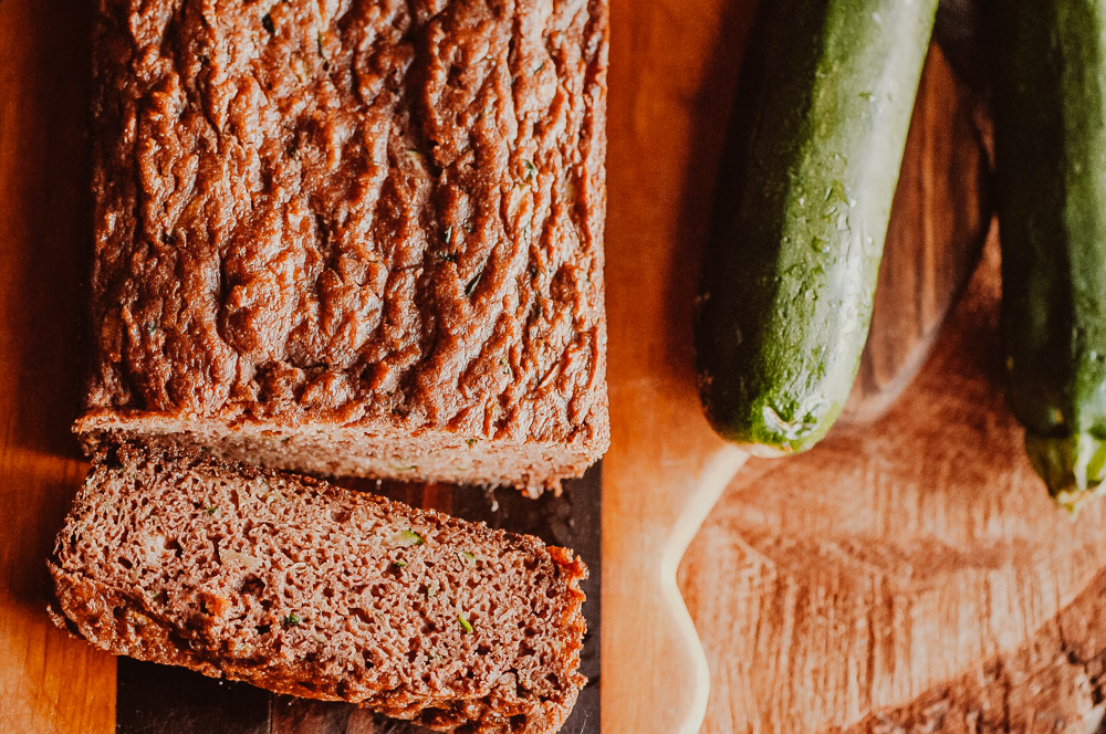 This easy Gluten-Free Zucchini Bread recipe is perfectly moist, fluffy and flavorful! This delicious and healthy bread made with coconut flour is gluten-free, dairy-free, soy-free, nut-free, refined sugar-free and slices like a dream! #zucchinibread #glutenfreezucchinibread #coconutflourzucchinibread #coconutflourbread