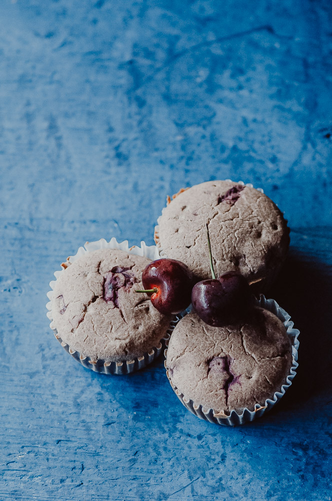 These fluffy Gluten-Free Cherry Muffins have a soft, spongy and juicy cherry cobbler center! Made with a blend of buckwheat flour and tapioca flour, these delightful muffins are super quick and easy to make and filled with pleasing textures and flavors. Gluten-free, vegan, dairy-free, soy-free, nut-free and refined sugar-free. #cherrymuffins #vegancherryrecipes #glutenfreecherrymuffins #buckwheatmuffins #cherrycobbler