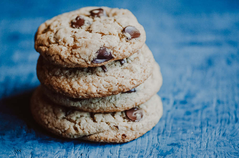 The BEST easy and healthy Vegan + Gluten-Free Chocolate Chip Cookies! These chewy cookies with crisp edges are made with homemade seed flour for an amazing texture, flavor and added nutritional powder! You only need one bowl to make them, too! #glutenfreechocolatechipcookies #veganchocolatechipcookies #glutenfreevegancookies #glutenfreeveganchocolatechipcookies #seedflourcookies #healthychocolatechipcookies