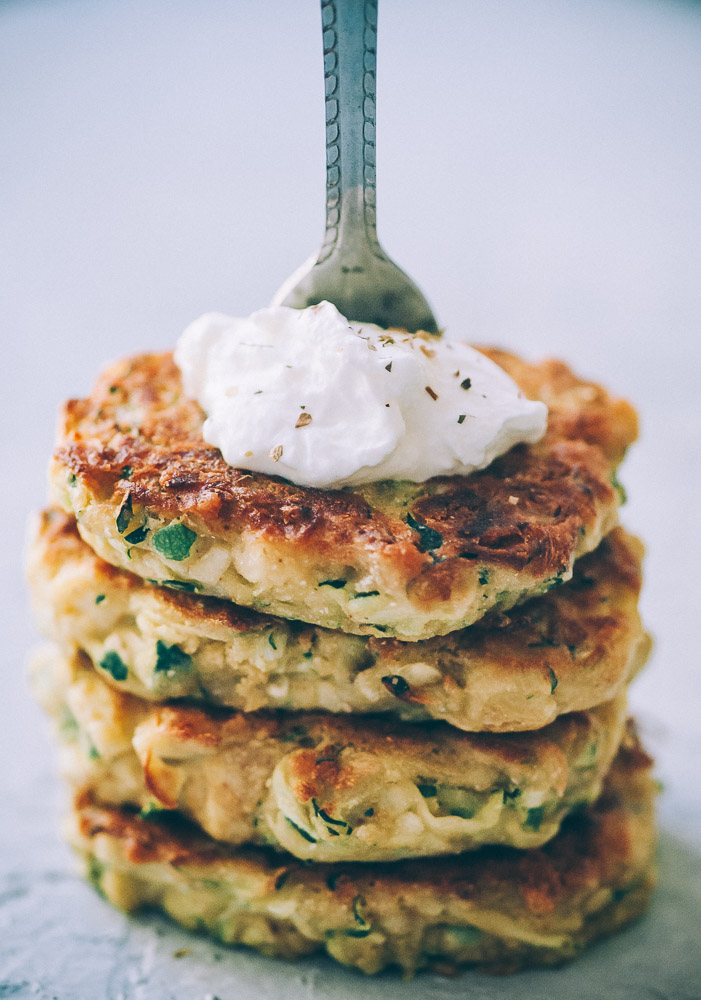 Super EASY, DELICIOUS AND HEALTHY Vegan Zucchini Fritters made with chickpea flour for that extra nutritional punch. These gluten-free vegan fritters are filled with loads of FLAVOR and could not be a tastier way to use that summer squash from your garden! #zucchinifritters #veganfritters #veganzucchinifritters #glutenfreezucchinifritters