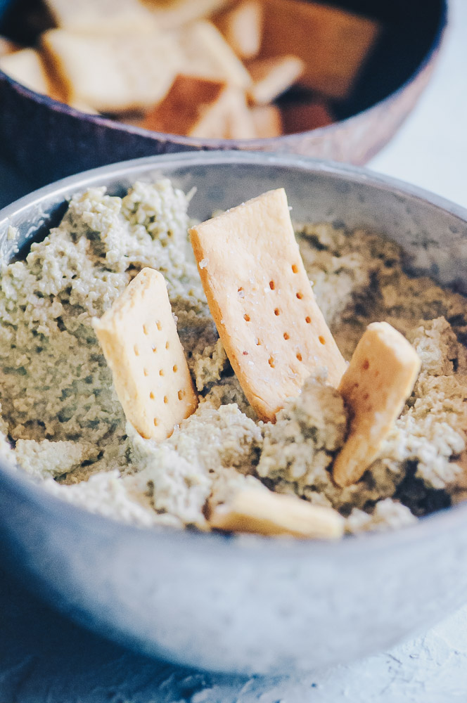 This super creamy and flavorful vegan cheese is made with sunflower seeds, pumpkin seeds or a blend for a super quick, easy and versatile vegan cheese recipe that is vegan, dairy-free, soy-free, nut-free, sugar-free and KETO! #vegancheese #vegancheeserecipe #seedcheese #easyvegancheese #vegancreamcheese