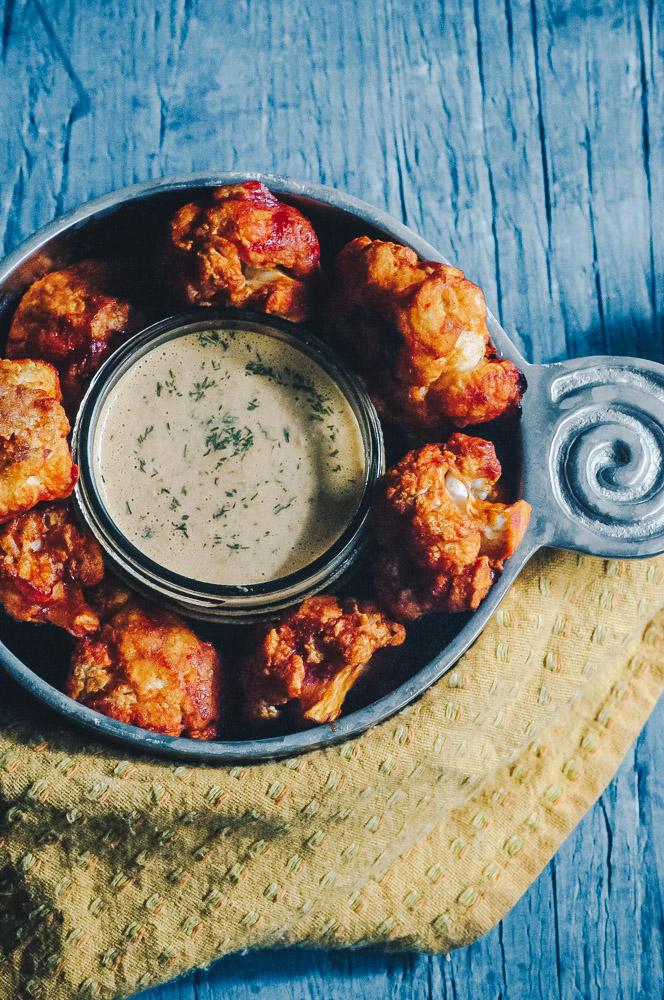 Super hearty and delicious Sweet and Spicy BBQ Cauliflower wings! These gluten-free vegan cauliflower bites are baked to perfection with a delightful spicy sweet sauce. Whether as a party appetizer or meal, these baked cauliflower wings are certain to impress! #cauliflowerwings #bbqcauliflowerwings #cauliflowerbites #vegancauliflowerwings #glutenfreecauliflowerwings