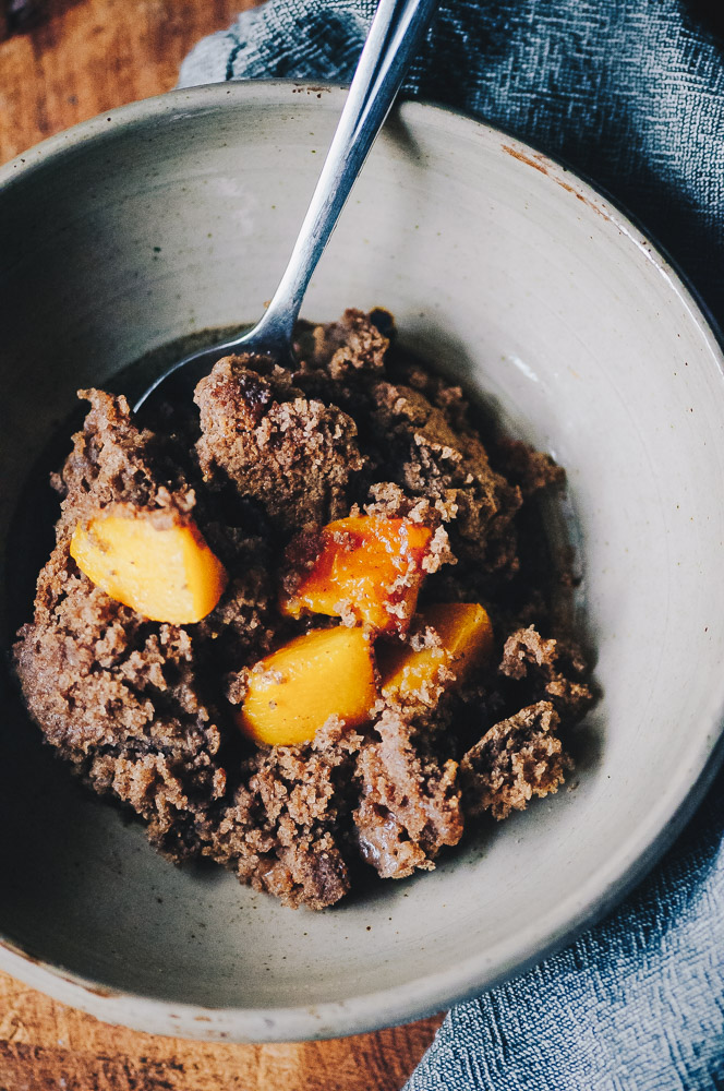 This easy and healthy gluten-free peach cobbler recipe is made with a blend of buckwheat and tapioca flours for a lovely flavor and texture that greatly complements juicy peaches for a heart-warming breakfast or dessert! Refined sugar-free with a dairy-free + vegan option! #glutenfreecobbler #glutenfreepeachcobbler #veganpeachcobbler #healthypeachcobbler
