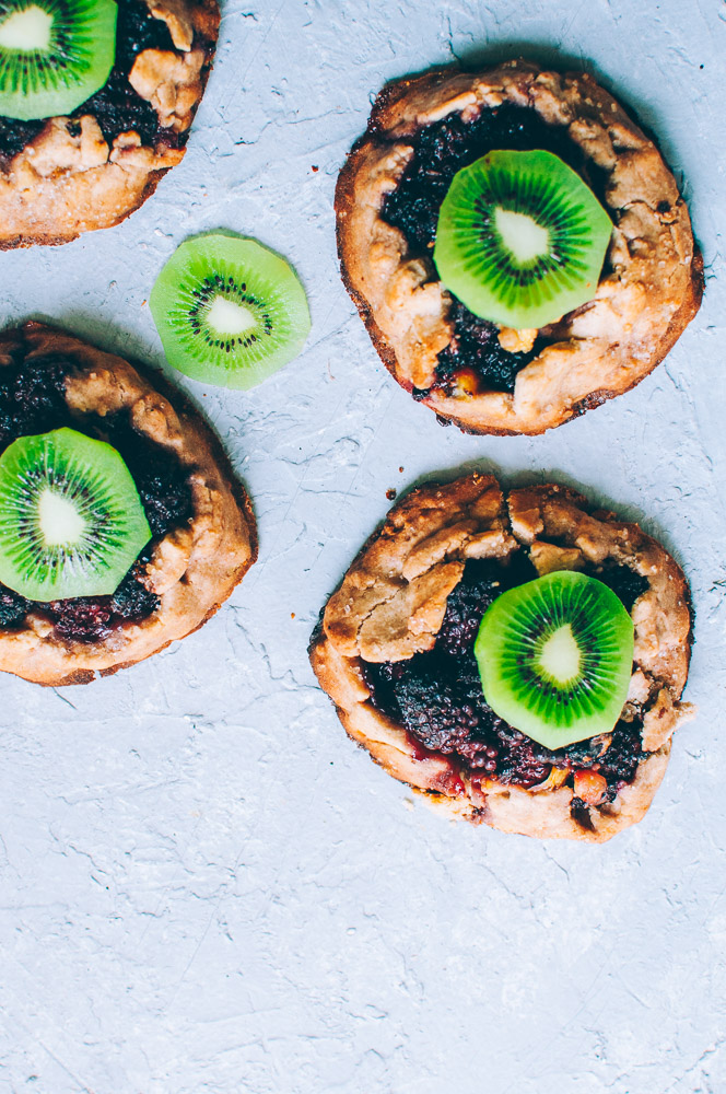 How-to make Mini Blackberry Kiwi Galettes -  These gluten-free vegan mini rustic pies are filled with juicy blackberries and tart kiwi for a fun twist! Easy, healthy, and delicious galettes are at your fingertips! #galette #galettes #minipies #rusticepies #kiwi #blackberries #glutenfreepie #veganpie #kiwipie