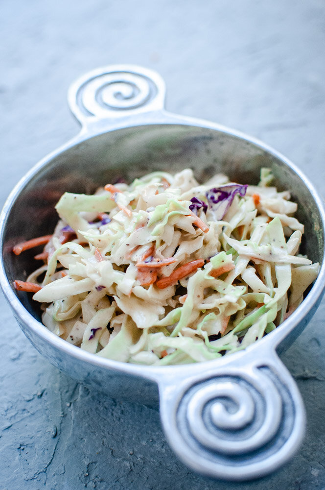 Creamy Vegan Coleslaw Recipe -  This creamy vegan take on a classic coleslaw salad recipe is rich, creamy, refreshing, crunchy, healthy and bursting with big flavor! This easy vegan coleslaw is perfect as is, or served in addition to your favorite summer meals. #vegancoleslaw #dairyfreecoleslaw