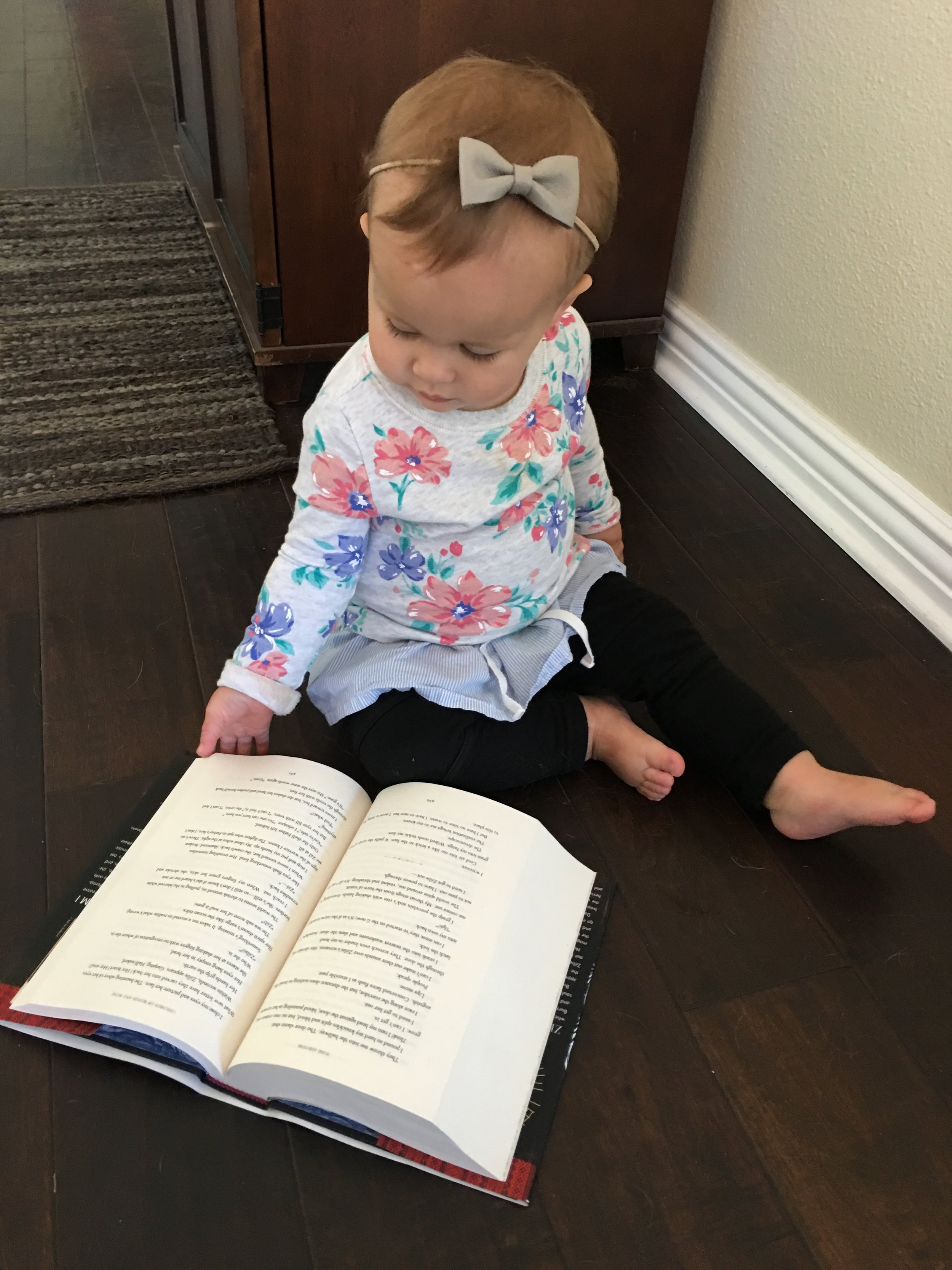 """Marlie """"reading"""" Children of Blood and Bone by Tomi Adeyemi"""