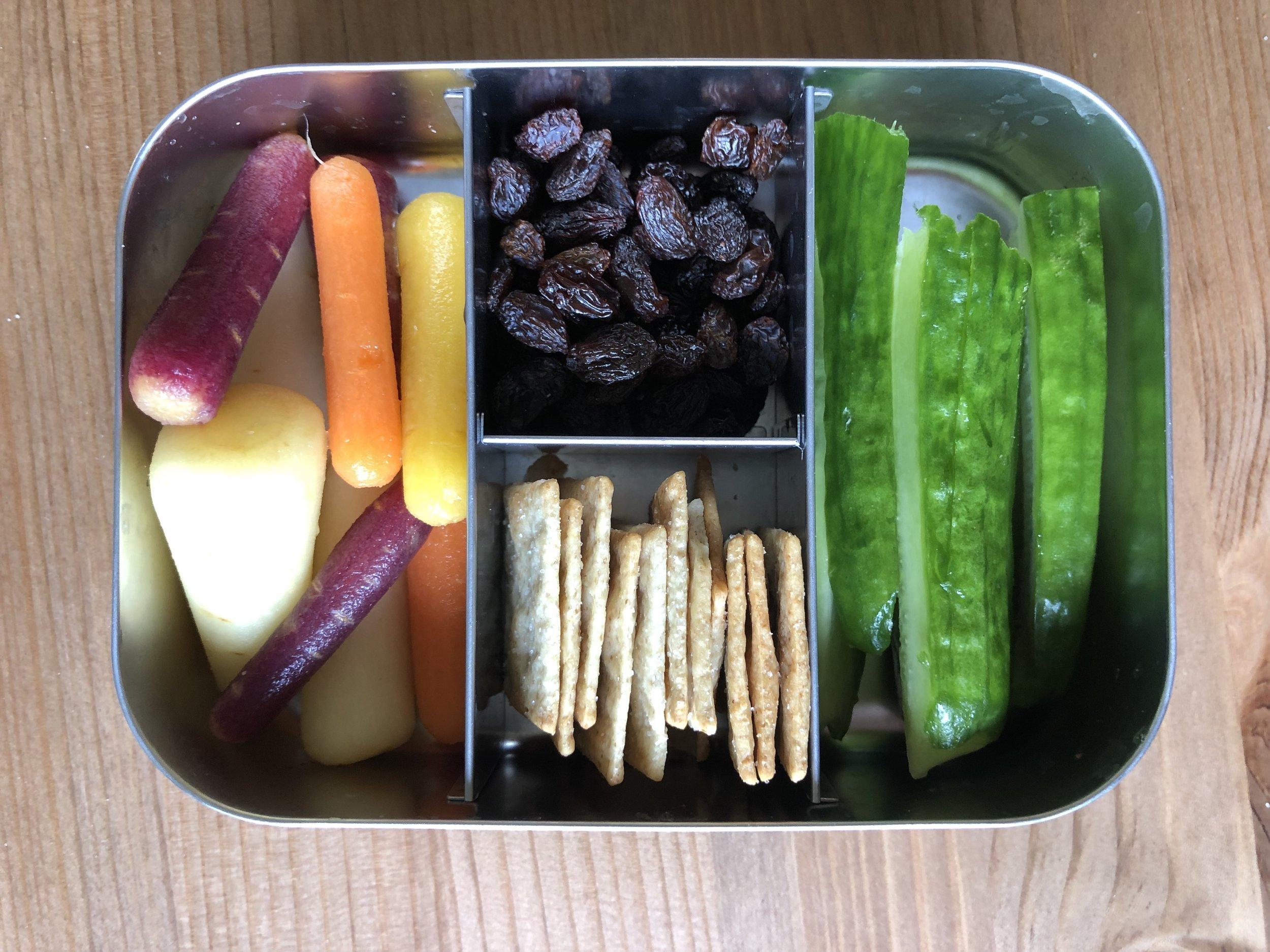 Organic Rainbow Carrots, raisins, paleo crackers cucumbers
