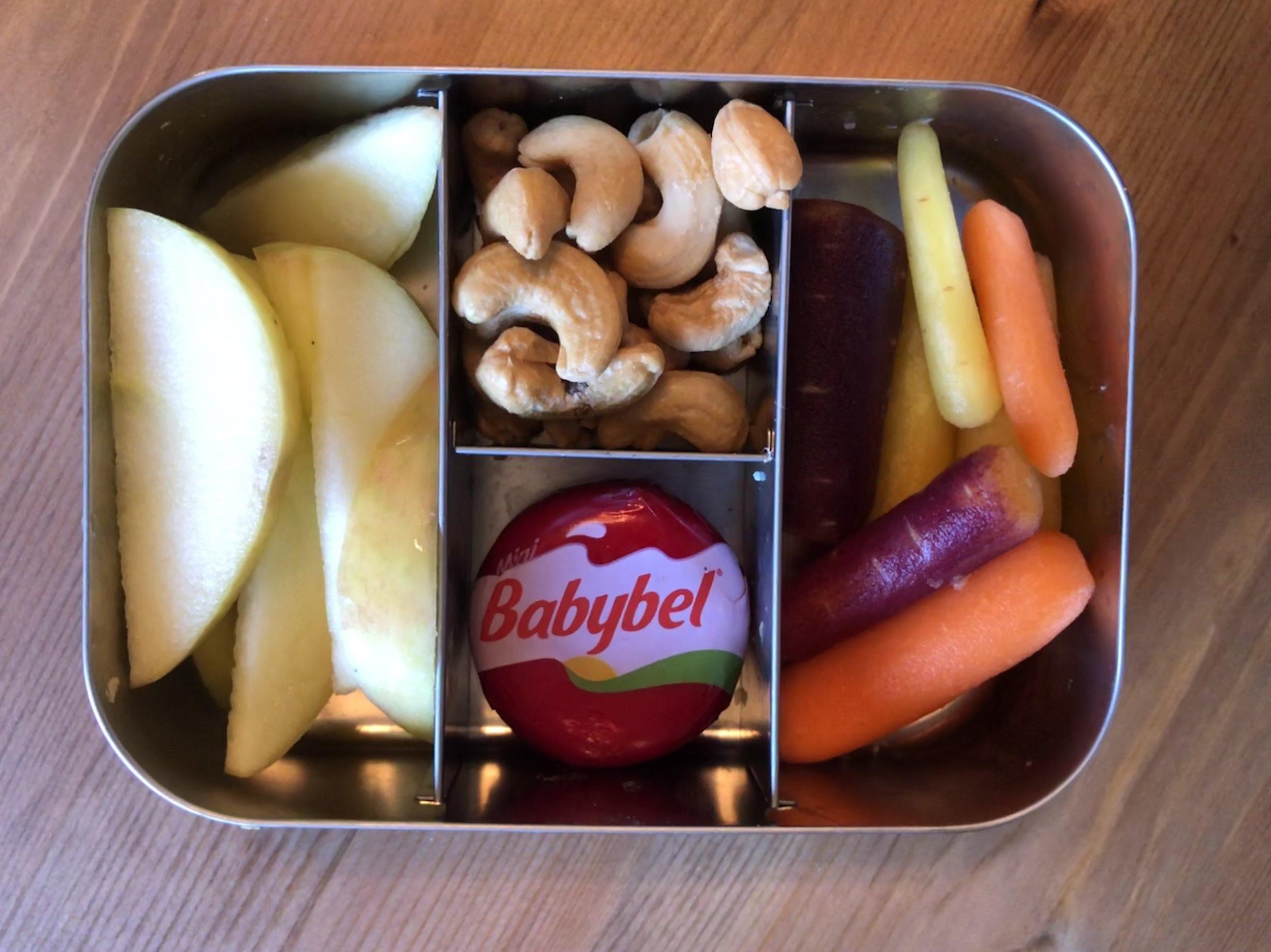 organic apple slices, cashews, babybel cheese, organic rainbow carrots.
