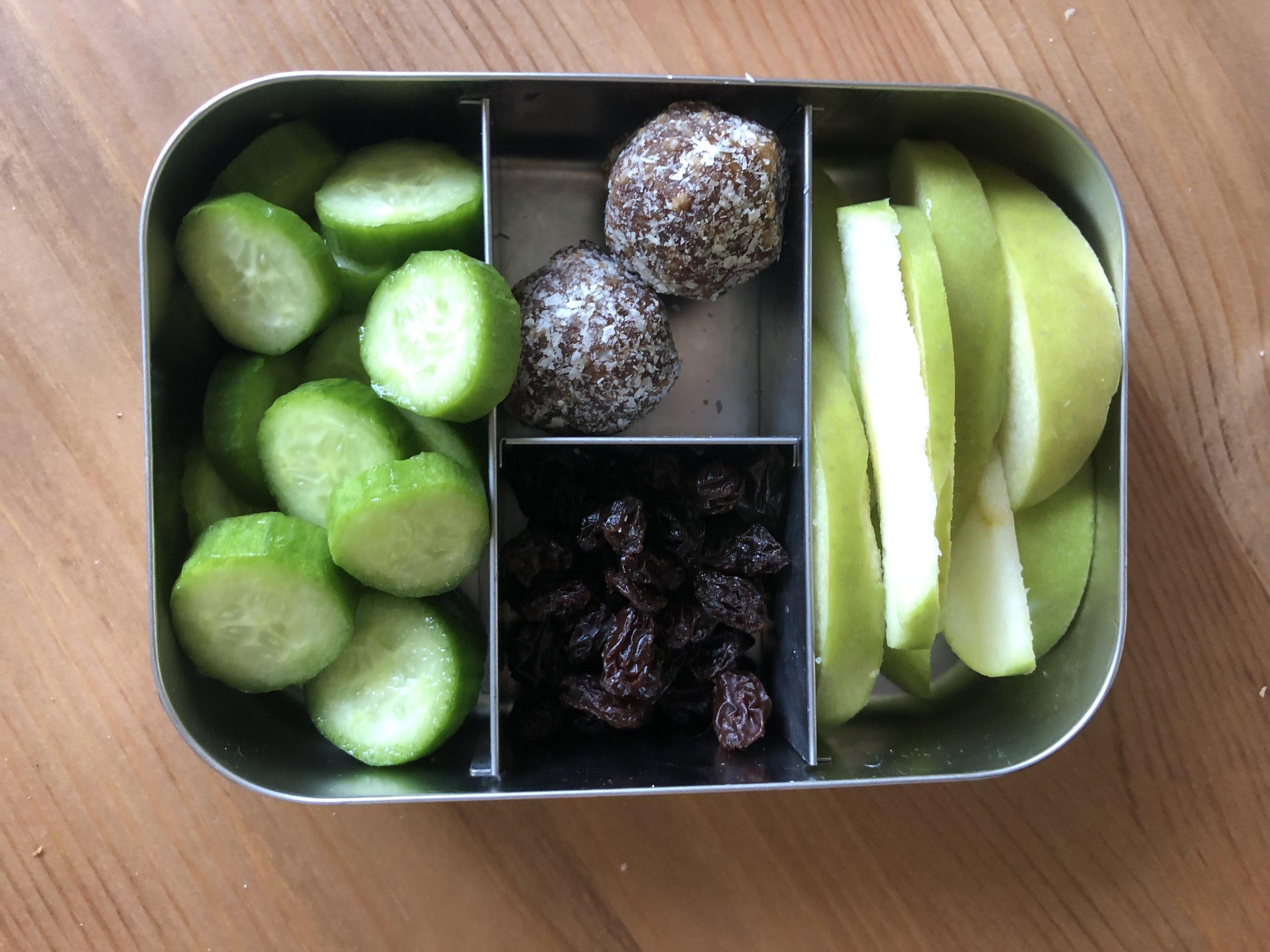 cucumbers, mango balls, raisins, apple slices