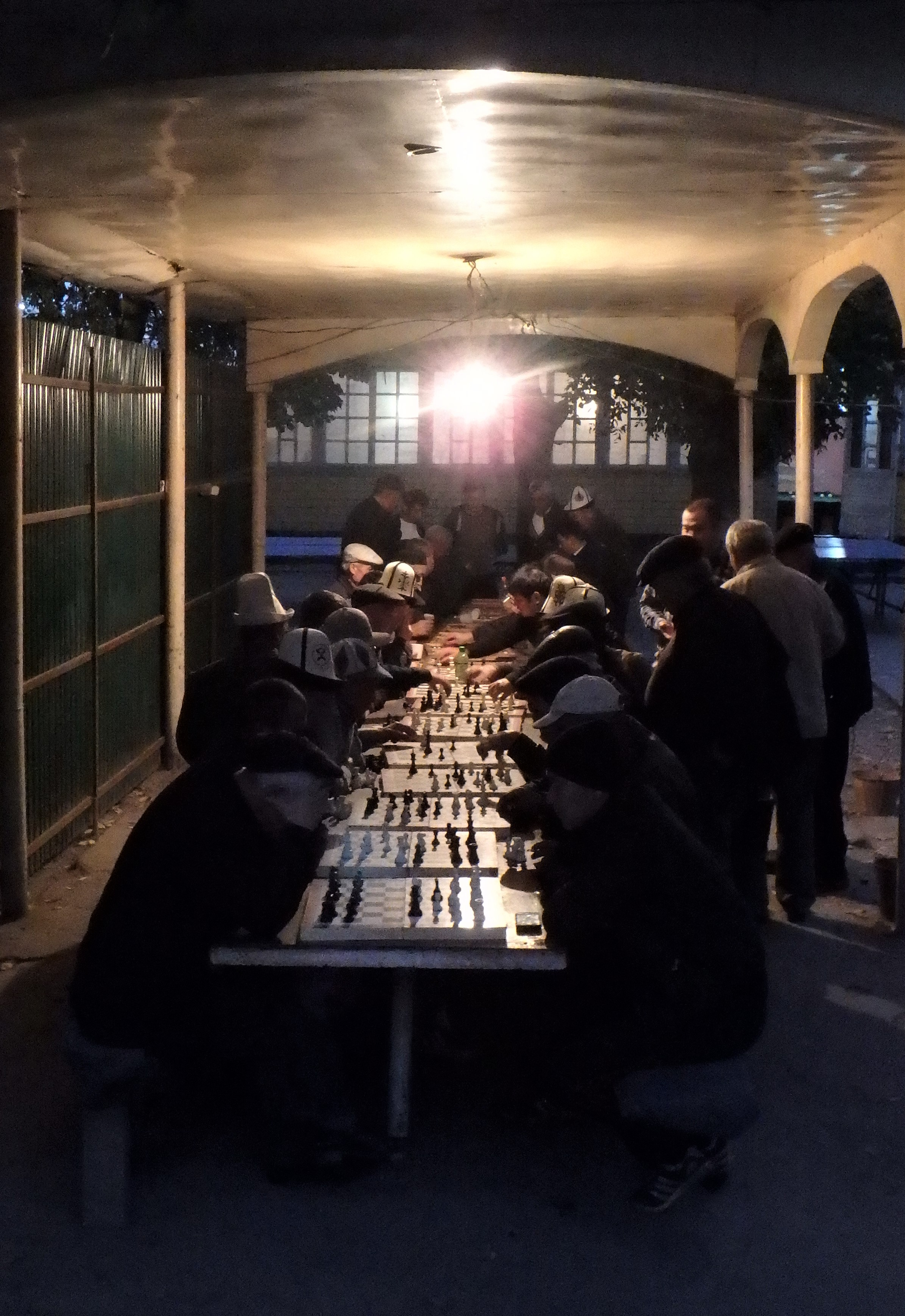 Old cats playing chess into the wee hours of the night in Osh.