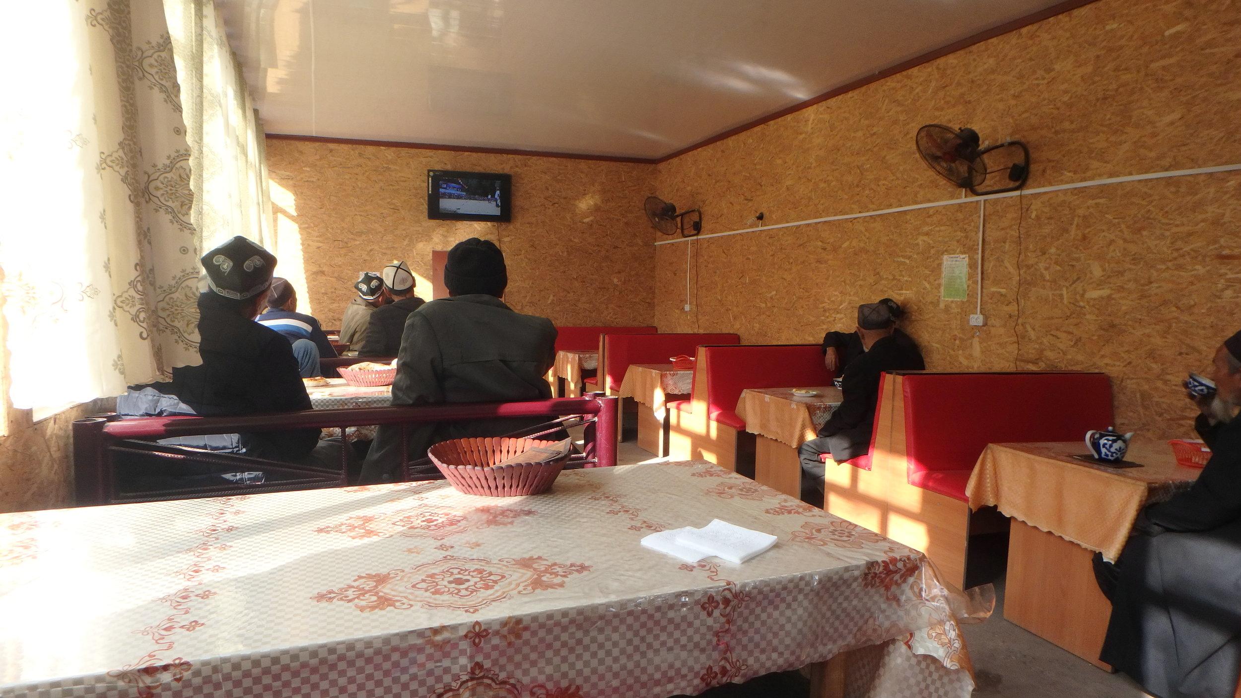 Watching nature documentaries in an Arslanbob Chaikhana (tea house).